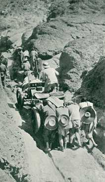Chinese Coolies helping the Itala through a narrow pass small